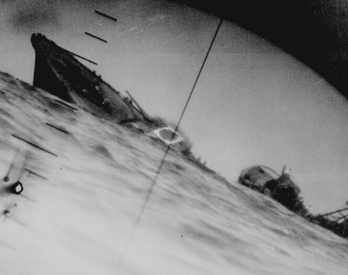 Periscope view of a sinking destroyer from a US sub in the Pacific.