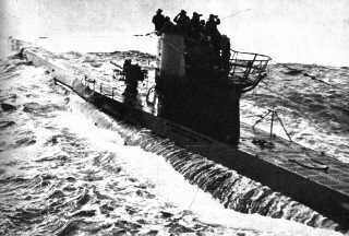 Water streams down from beneath the outer hull of a Type VII U-boat.