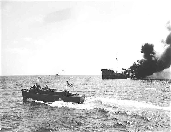 """A burning tanker off the American coast during the U-Boat """"Second Happy time""""."""