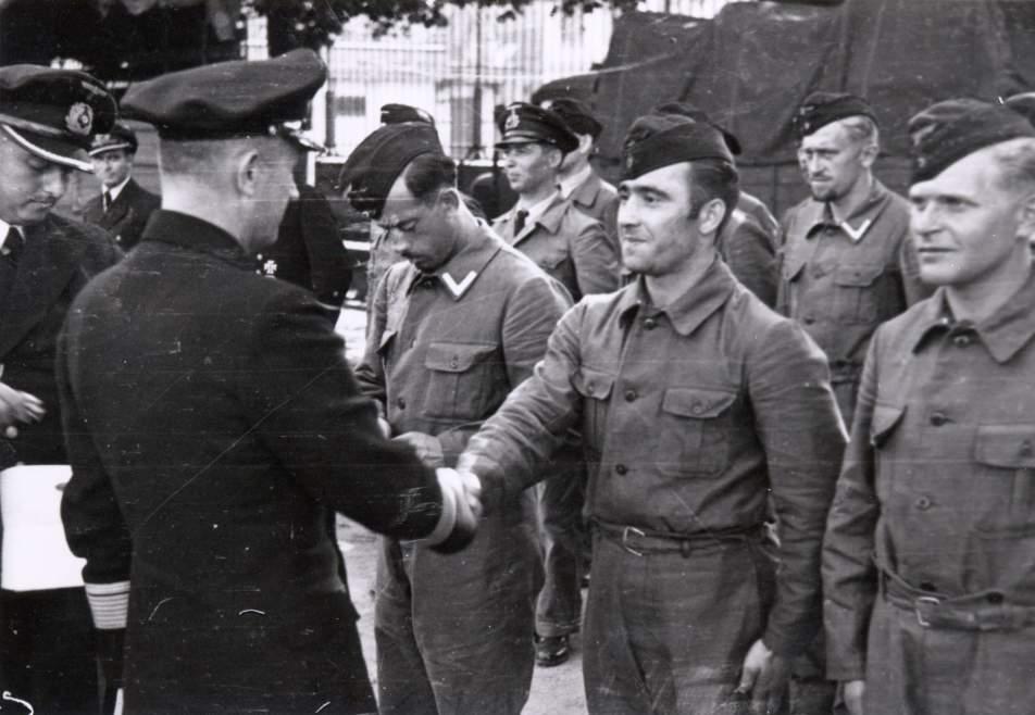 Donitz greets the returning U-boat crew after a war patrol.