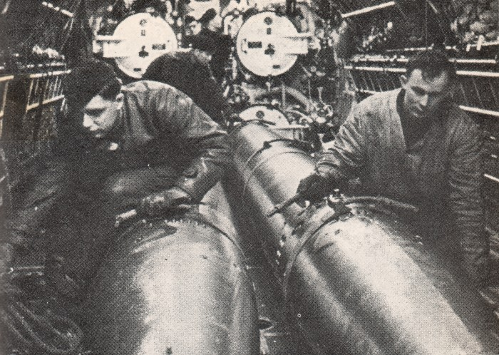Preparaton torpedos for attack on convoy