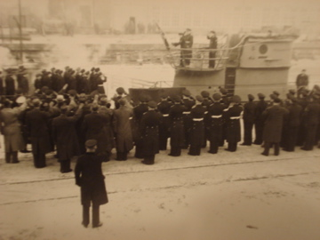 U-410 during her commissioning ceremony 23 Feb 1942. There is an inscription at the...