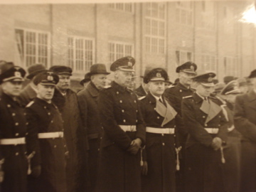 Kriegsmarine authorities and civilian workers witness the commissioning ceremony...
