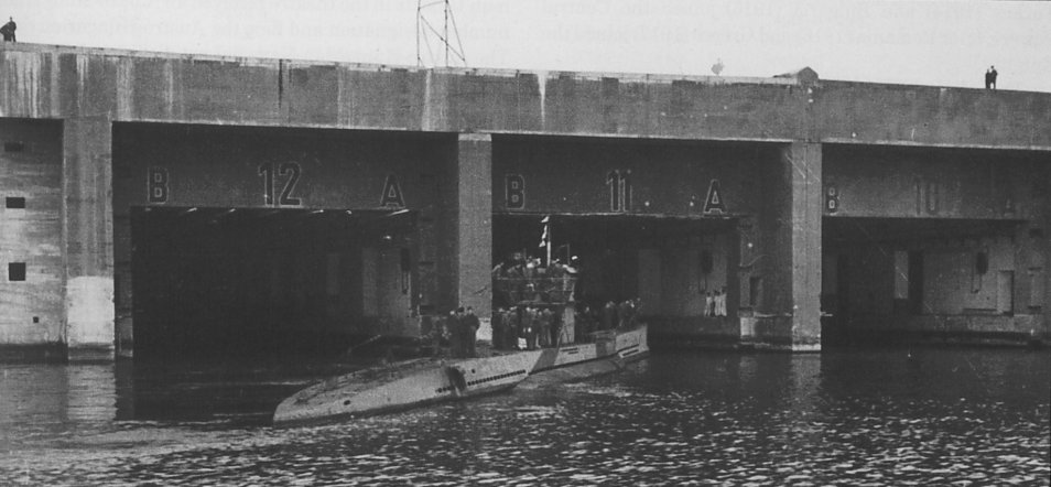 U-136 sails into a bunker in Lorient. Note the bunker numbers.