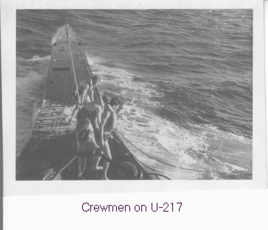Taken from the conning tower of U-217, crewmen can be seen wearing life lines which...