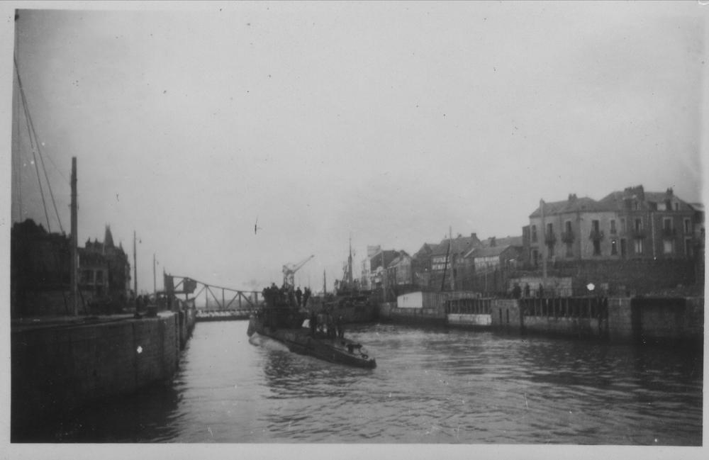 A U-boat entering St. Nazaire by way of the  Nouvelle Écluse (New floodgate). Photos...
