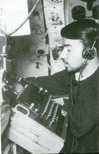 A crew aboard U-110 operates the Enigma machine.