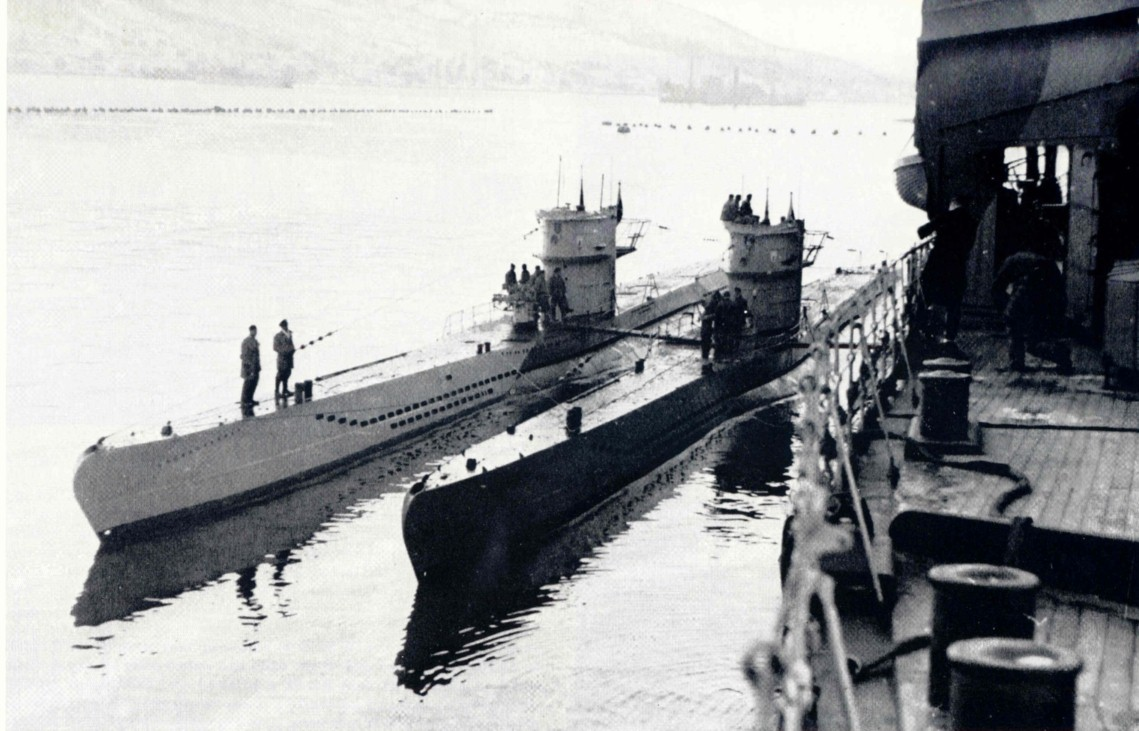 Two Type VIIC of the 11th flotilla next to a supply ship.