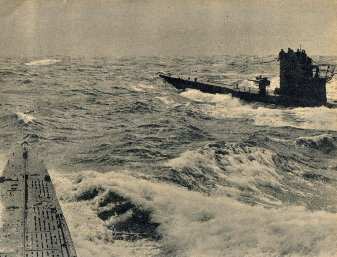 A Type VII u-boat rendezvous at sea. Judging from the bridge design, and the single...